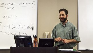 professor standing at front of classroom