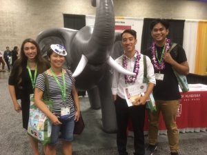 Photo of Dr. Veny Liu and her students with an inflatable elephant