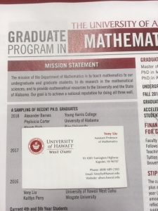 A photo of Dr. Liu's nametag placed on a Math Department Graduate Program Flyer