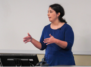 A photo of Dr. Mojdeh Rasoulzadeh standing in the front of a classroom.